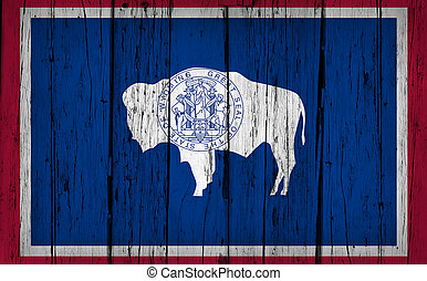 Wyoming Flag Grunge Wooden Background