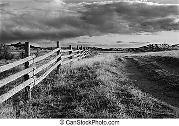 wyoming landscape - fence running through the landscape of...