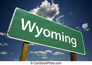 Wyoming Road Sign with dramatic clouds and sky.