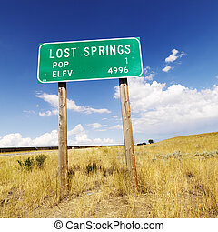 Wyoming road sign. - Population and elevation sign for Lost ...