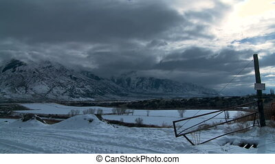 Wyoming Winter Time-lapse - An old desolate road leading up...