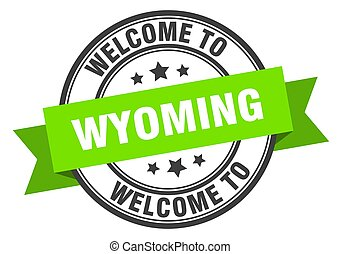 Wyoming stamp. welcome to Wyoming green sign