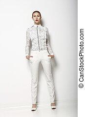 wysoki, fashion., modny, kobieta, w, biały, bryczesy, w, łania, pose., skoczcie czas, zbiór