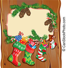 X-mas and New Year card with family Christmas stockings on wood background. Frame with empty space for text.