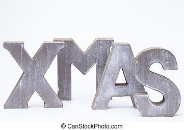 X-Mas - Capital letters forming the word xmas over white