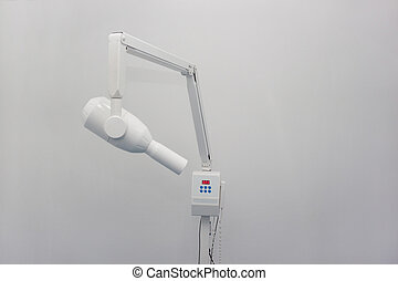X-ray machine in the dental clinic isolated on a white background.