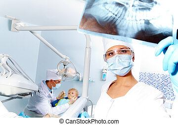 X-ray photography - Portrait of assistant looking at...