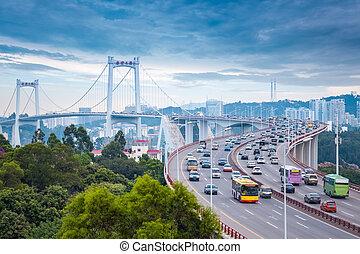 xiamen haicang bridge at dusk with busy traffic