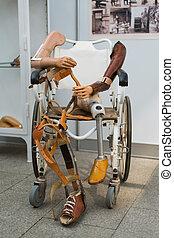 XIX century artificial limbs on historical wheelchair