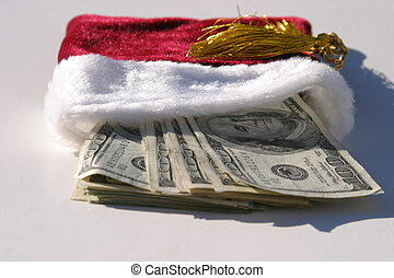 xmas cash on a white background in a red and white gift bag with a gold draw string