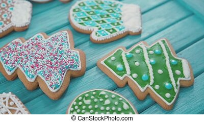 Xmas cookies in the shape of a heart, mitten. Confectionery sprinkle