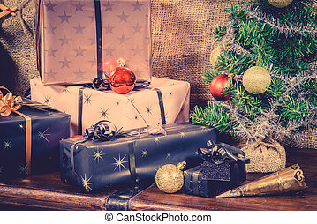 Xmas gifts in vintage colors - Xmas gifts under the tree in...