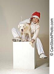 Xmas girl holding a white dog