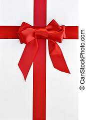 xmas holiday gift package with red bow and ribbon