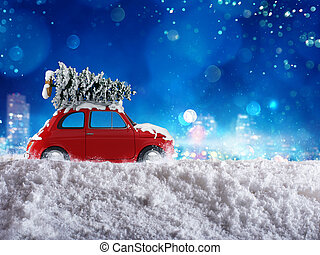 Xmas holiday travel - Christmas tree on the roof of a car...