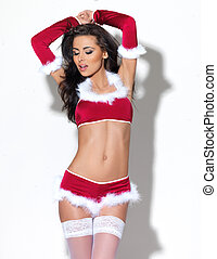 Xmas Lingerie - Sexy brunette woman posing xmas lingeire