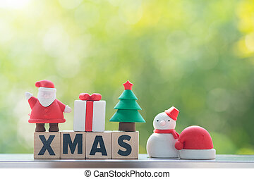Xmas make by wooden block with Christmas ornament