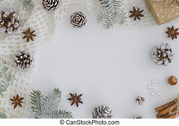 Xmas new year frame. Christmas hand made gift box, pine cones, fir tree branches, cinnamon sticks, anise star on white background. Top view, flat lay, copy space. hero header mockup