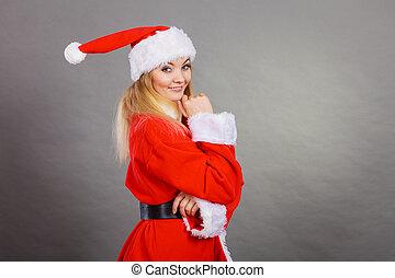 Happy woman wearing Santa Claus helper costume