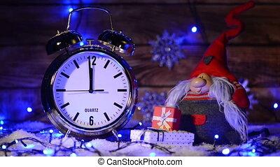 Xmas set with big alarm clock counting to twelve o'clock
