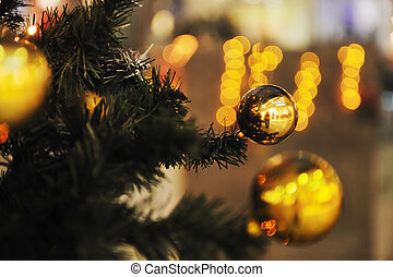 xmas tree decoration closeup with blured lights in shopping centre in backgroun