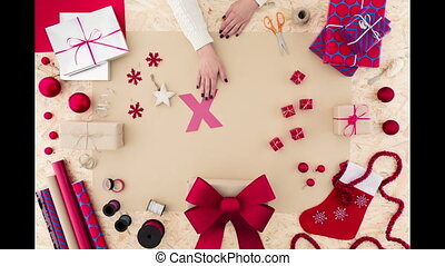 Xmas word on brown background - Female hands building Xmas...