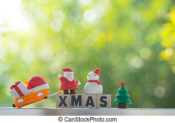 Xmas word on wooden block with Christmas ornament