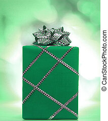 green Christmas gift with silver ribbon and bow