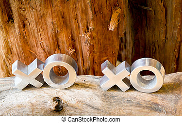 Hugs and kisses symbols xoxo on a rustic wooden background with copy space