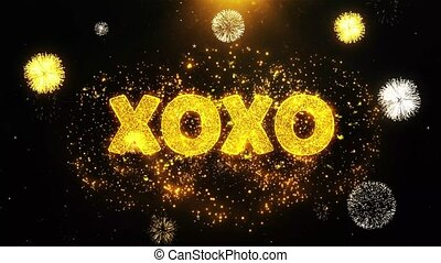 XOXO Text on Firework Display Explosion Particles.
