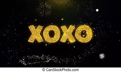 XOXO Text on Gold Particles Fireworks Display.