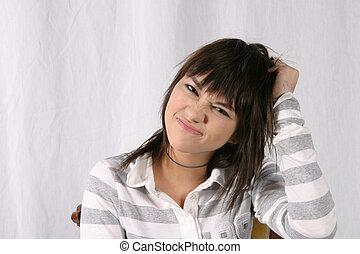 Ya think? - pretty brunette teenage girl wrinkling her nose