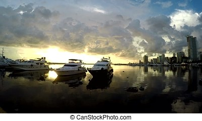 yacht anchored on sea shore bay under twilight dusk sunset....