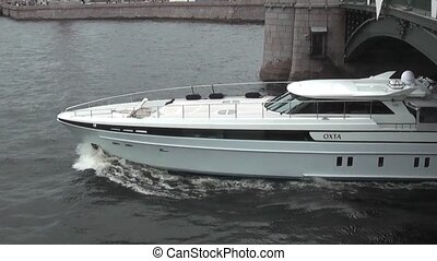Yacht and boat excursion arise from under the bridge