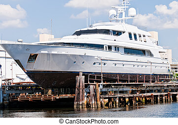 Yacht and marina - Yacht being repaired in a Miami Marina...