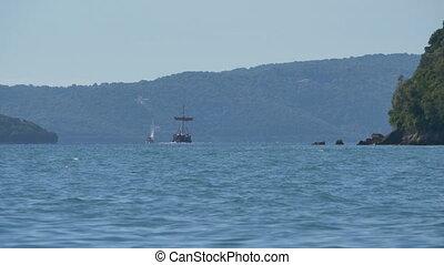 Yacht and Ship near Greek Island