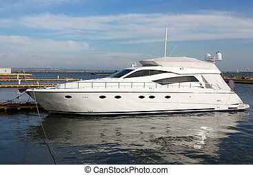 yacht at berth in marina