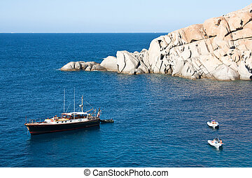 Lovely yacht in the blue sea at Capo Testa, Sardinia.