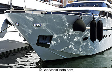 Yacht at Port - Water reflections on the bow of a super...