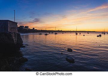 Yacht at sunrise in ocean bay