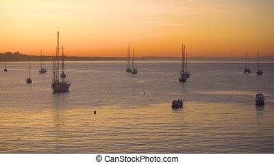 Yacht at sunrise in ocean bay. magical seascape