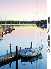 Yacht at sunrise - Yacht at the wooden dock in early morning...