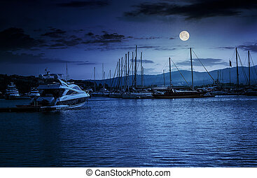 yacht at the pier at night - yacht at the pier of the old...