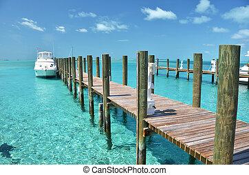 Yacht at the wooden jetty. Exuma, Bahamas