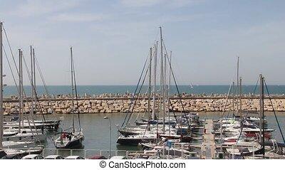 Yacht begins mooring in the marina
