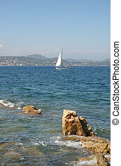 Yacht from St Tropez - Yacht in the bay with rocks in...