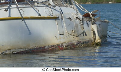Yacht Hull Wreck on Waters - A yacht hull wreck on the...
