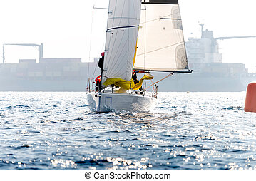 Yacht in action during a race in the mediterranean sea
