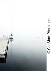 yacht in fog