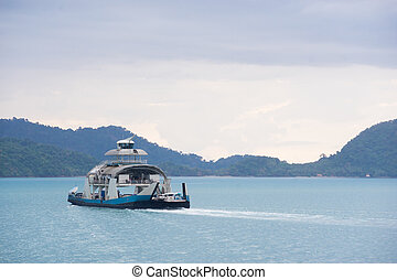 Yacht in the ocean with island background